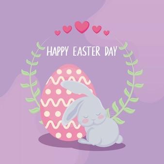Szczęśliwa easter dnia karta z ślicznym królikiem i jajkiem