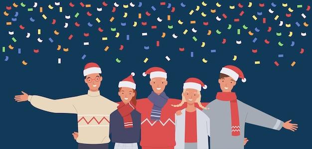 Szczęśliwa grupa ludzi na przyjęciu świąteczno-noworocznym.