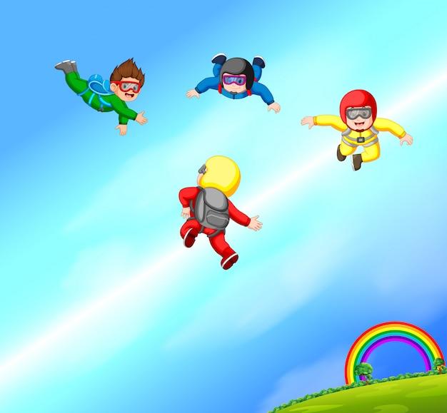 Szczęśliwa grupa skoczków spadochronowych