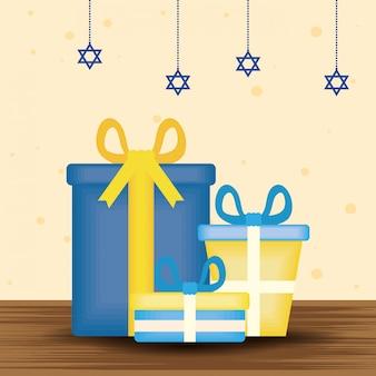 Szczęśliwa hanukkah ilustracja z prezentami i gwiazd wieszać