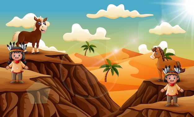 Szczęśliwa indyjska chłopiec i dziewczyna z pustynnym krajobrazem