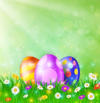 Szczęśliwa kartka wielkanocna z jajkami, trawą, kwiatami