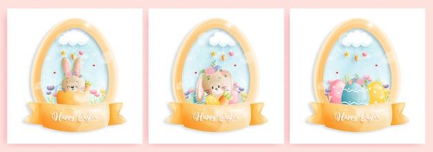 Szczęśliwa kartka wielkanocna z uroczymi króliczkami w kształcie jajka.