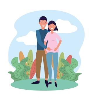 Szczęśliwa kobieta i mężczyzna para w ciąży i roślin