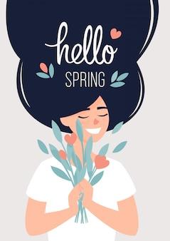 Szczęśliwa kobieta trzyma bukiet kwiatów i tekst cześć wiosna