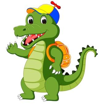 Szczęśliwa kreskówka krokodyl idzie do szkoły