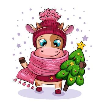 Szczęśliwa kreskówka krowa w ciepłej czapce i szaliku idzie po śniegu z choinką ze złotą gwiazdą.