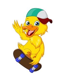 Szczęśliwa mała żółta kaczka grająca na deskorolce