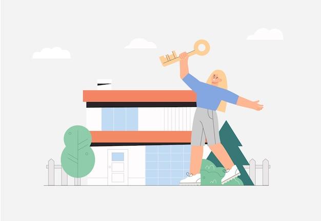 Szczęśliwa młoda kobieta skacze z radością trzymając klucz na domu