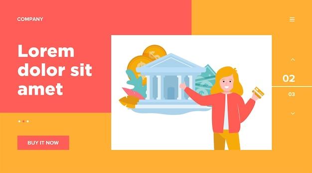 Szczęśliwa młoda kobieta trzyma kartę kredytową. budynek banku, pieniądze, szablon sieci web gotówki