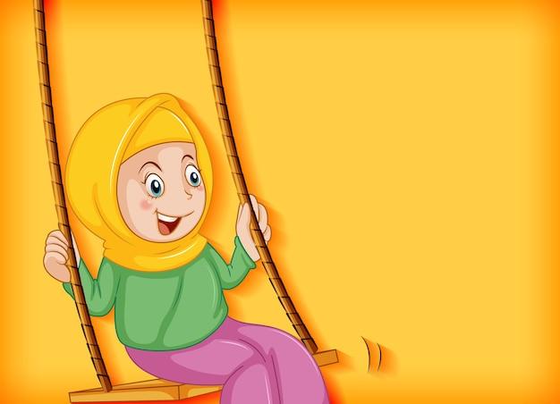 Szczęśliwa muzułmańska dziewczyna siedzi na huśtawce