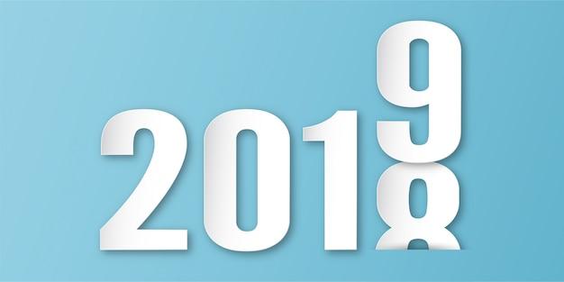 Szczęśliwa nowy rok 2019 dekoracja na błękitnym tle w papieru cięciu i cyfrowym rzemiośle.