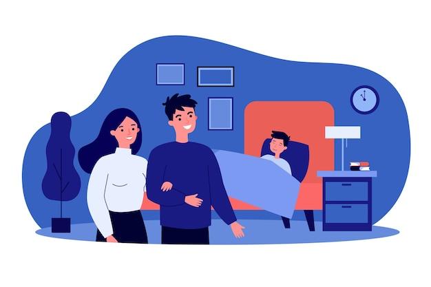 Szczęśliwa para ogląda śpiącego syna