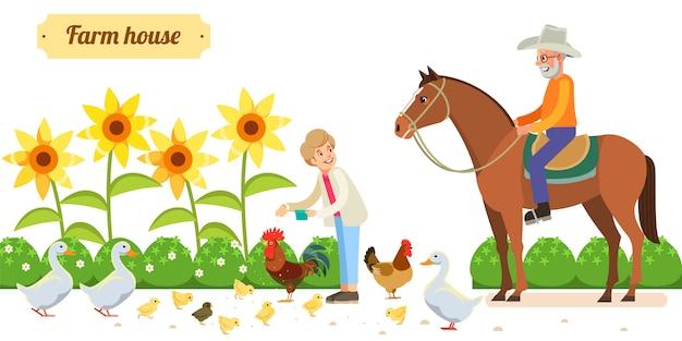 Szczęśliwa para starszych ze zwierzętami i ptakami w ekologicznym gospodarstwie wiejskim