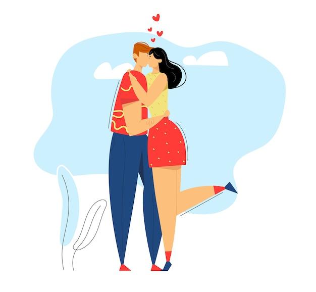 Szczęśliwa para zakochanych. mężczyzna całuje swoją dziewczynę. kobieta przytula chłopaka.