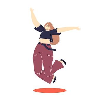 Szczęśliwa podekscytowana dziewczyna skacze z podniecenia.