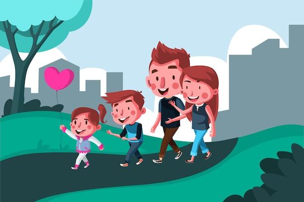 Szczęśliwa rodzina bawi się razem w parku