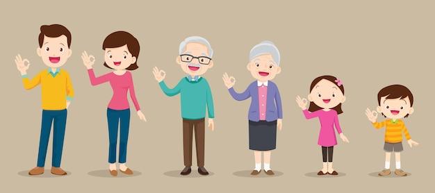 Szczęśliwa rodzina i dzieci pokazujące w porządku gest znak