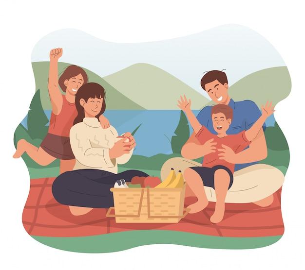 Szczęśliwa rodzina ma pinkin w parku