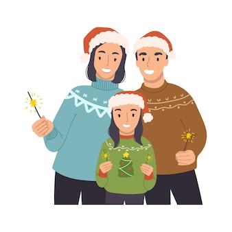 Szczęśliwa rodzina mama, tata i córka świętują boże narodzenie i nowy rok.