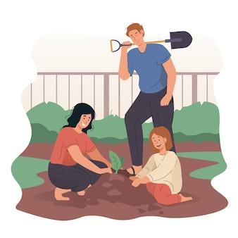Szczęśliwa rodzina razem ogrodnictwo w ogrodzie przydomowym