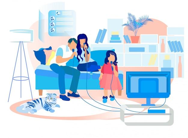 Szczęśliwa rodzina siedzi na kanapie singing karaoke w telewizji