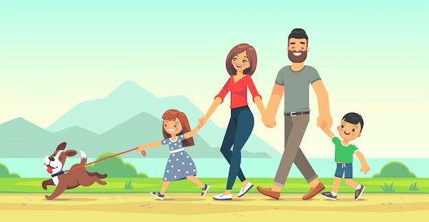 Szczęśliwa rodzina spacery po drodze wzdłuż morza. ojciec, matka, syn i córka razem na zewnątrz.