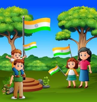 Szczęśliwa rodzina trzyma flagi narodowej na charakter