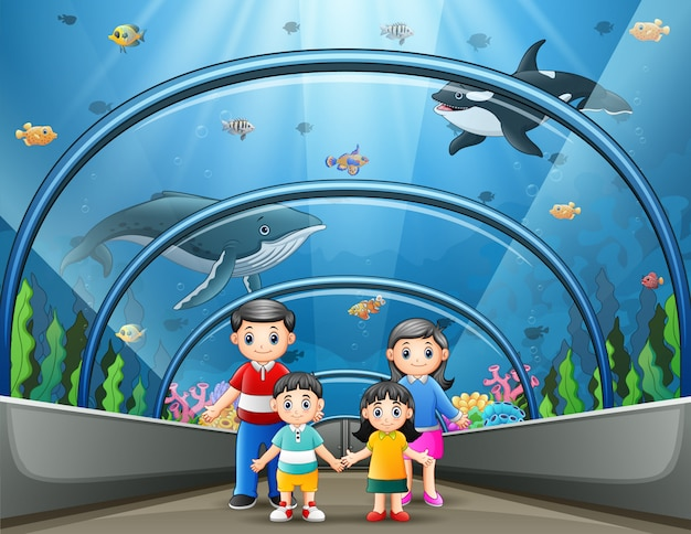 Szczęśliwa rodzina w akwarium morskim