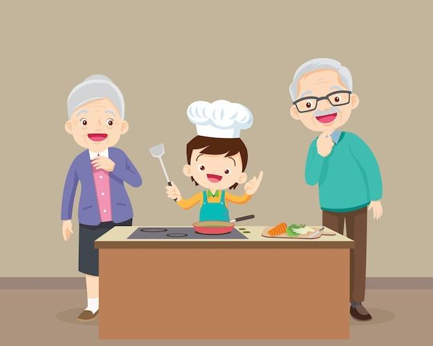 Szczęśliwa rodzina z dziadkiem i wnukiem gotuje w kuchni