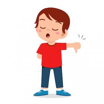 Szczęśliwa śliczna dzieciak chłopiec z kciuka puszka znakiem