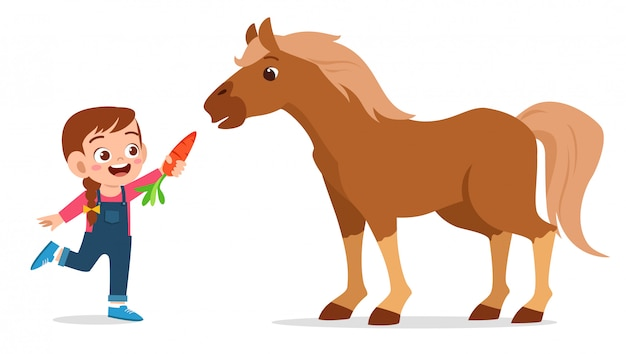 Szczęśliwa śliczna dzieciak dziewczyna karmi ślicznego konia