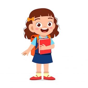 Szczęśliwa śliczna dzieciak dziewczyna przygotowywająca iść szkoła