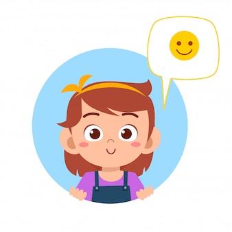 Szczęśliwa śliczna dzieciak dziewczyna z emoji wyrażeniem