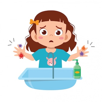szczęśliwa śliczna małe dziecko dziewczyna myje rękę w zlew