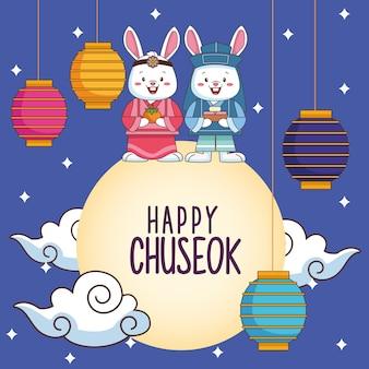 Szczęśliwa uroczystość chuseok z parą królików i lampami wiszącymi na księżycu