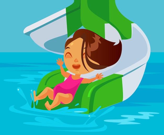 Szczęśliwa uśmiechnięta dziewczynka jeżdżąca na zjeżdżalni wodnej w parku wodnym
