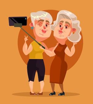 Szczęśliwa uśmiechnięta kobieta babcia znaków dokonywanie selfie
