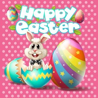 Szczęśliwa wielkanoc z królikiem i jajkami na różowym tle