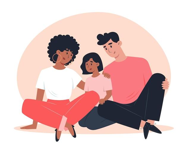 Szczęśliwa wielokulturowa sieć siedzi na podłodze i przytulanie