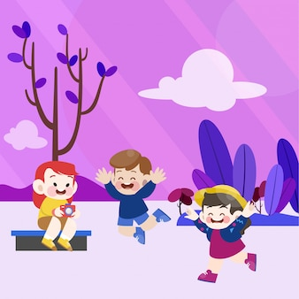 Szczęśliwe dzieci bawią się razem w ogrodzie