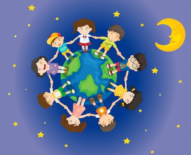 Szczęśliwe dzieci otaczające ziemię