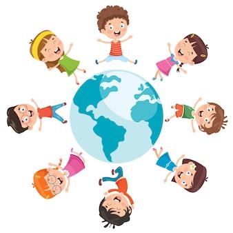 Szczęśliwe dzieci pozuje na ziemi
