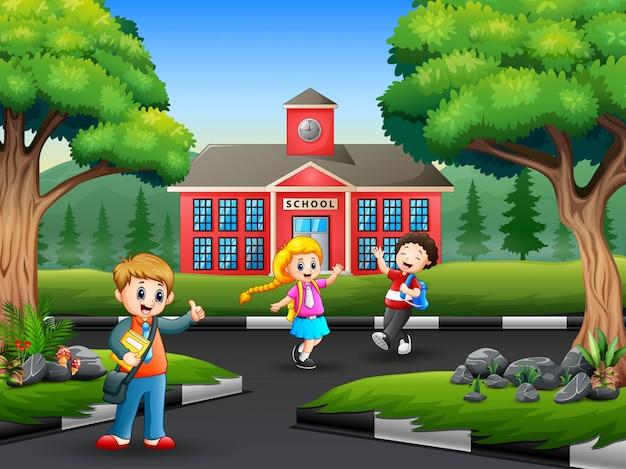 Szczęśliwe dzieci żegnają się z przyjacielem po szkole