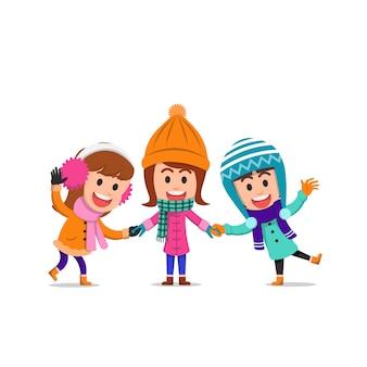 Szczęśliwe dziewczynki w zimowe ubrania