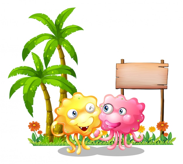 Szczęśliwe potwory w pobliżu pustych oznakowań obok palm