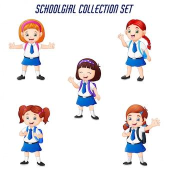 Szczęśliwe szkolne dziewczyny w różnym pozować secie