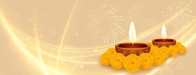 Szczęśliwego diwali błyszcząca diya i transparent kwiat nagietka