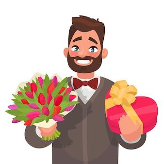 Szczęśliwego międzynarodowego dnia kobiet. przystojny mężczyzna z bukietem kwiatów i prezentem. element karty z pozdrowieniami.