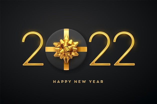 Szczęśliwego nowego 2022 roku. złote metaliczne luksusowe numery 2022 z pudełkiem prezentowym ze złotą kokardą na czarnym tle. realistyczny znak dla karty z pozdrowieniami. świąteczny plakat lub transparent wakacje. ilustracja wektorowa.